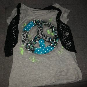 A girls shirt with sewed in vest